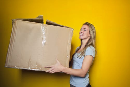 Woman holding a huge box
