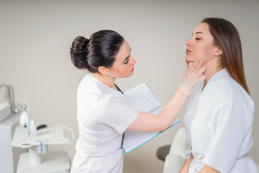 Dermatologist checking a patient inside a skin cancer clinic in Melbourne