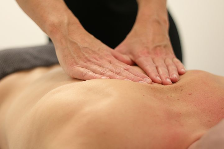 Patient with back pain getting treated by a chiropractor in Baulkham Hills
