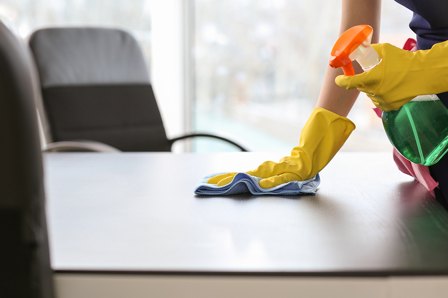 Regular building cleans professional cleaning the office table
